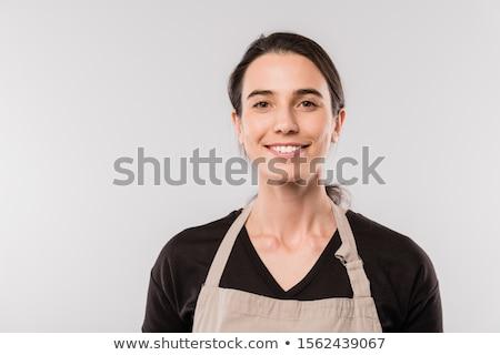 Bastante jóvenes morena camarera delantal mirando Foto stock © pressmaster