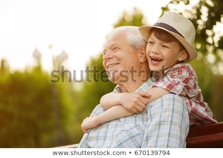 Nagyapa unoka ül szék olvas könyv Stock fotó © jossdiim