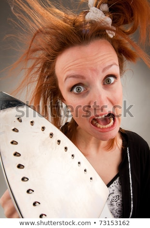 Screaming housewife with steam iron Stock photo © nomadsoul1
