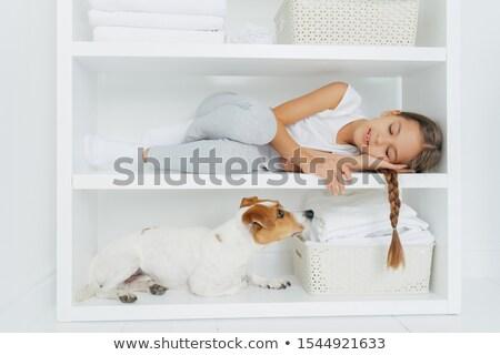 Senny dziewczynka wygodny leży biały półka Zdjęcia stock © vkstudio