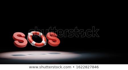 SOS Text Lifebelt Spotlighted on Black Background 3D Illustration Stock photo © make