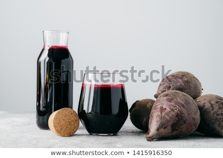 Red beetroot juice in glass containers, fresh beet for making beverage. Vegetable drink. Organic hom Stock photo © vkstudio