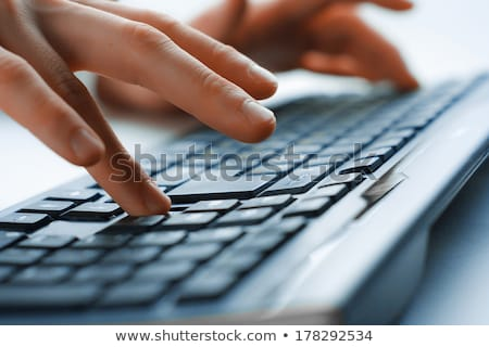 Man Using Tool To Press Button Stock photo © AndreyPopov