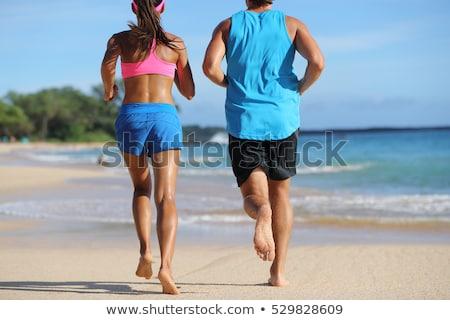 Frau Läufer läuft barfuß Sand Strand Stock foto © Maridav