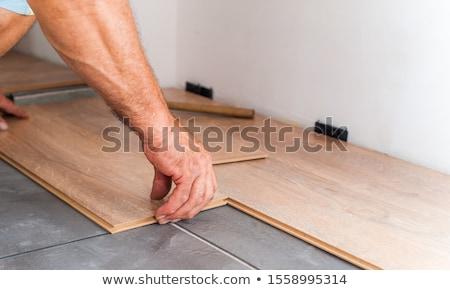 man laying laminate flooring panels stock photo © photography33