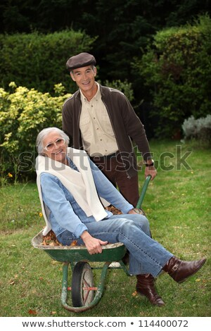 older couple messing around with a wheelbarrow stock photo © photography33
