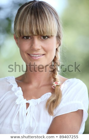 Young woman with a blunt fringe outdoors Stock photo © photography33