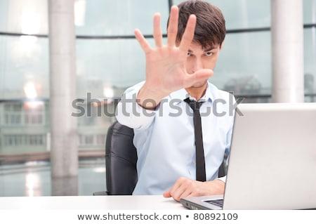 komoly · fiatal · üzletember · néz · számítógép · kép - stock fotó © hasloo