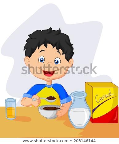 Stock photo: Man with little girl having breakfast