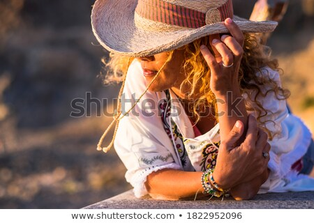 beautiful blonde in bracelet Stock photo © zastavkin