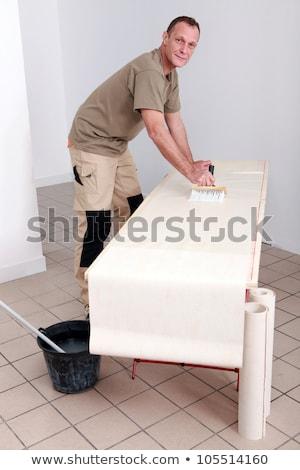 Artisan gluing wallpaper Stock photo © photography33