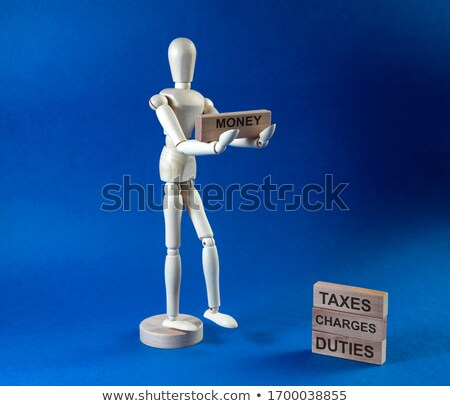 Businessman holding bills and toy blocks Stock photo © photography33