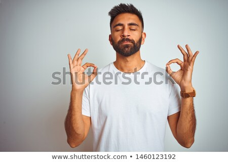 happy fit male posing over white background stock photo © dash