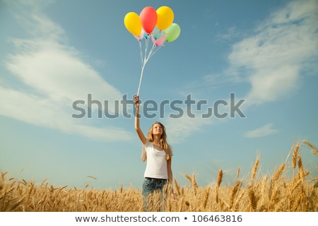 Stockfoto: Teen Girl At A Wheat Field With Balloons