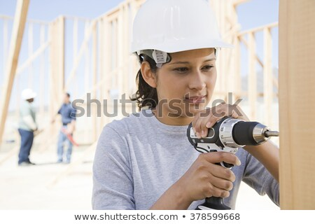 Woman constructing wooden frame Stock photo © photography33