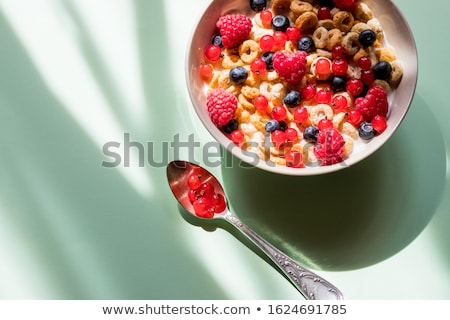 deliscious healthy breakfast with flakes and fruits isolated stock photo © juniart