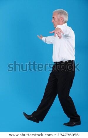 senior businessman pretending to walk on wire stock photo © photography33