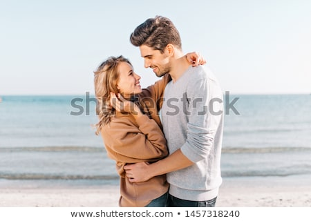 Woman and man embracing in the water Stock photo © photography33