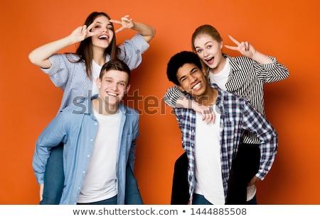teen · vent · vriend · op · de · rug · gelukkig · paar - stockfoto © wavebreak_media