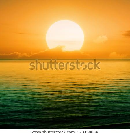 Gouden oranje zonsondergang heldere hemel oceaan strand Stockfoto © Frankljr