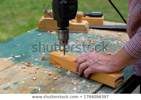 Woodworker using drill Stock photo © photography33