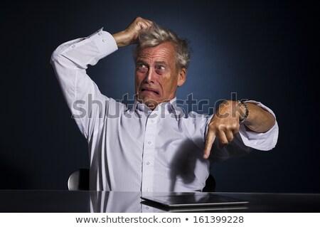 Anxious businessman tearing at his hair Stock photo © smithore