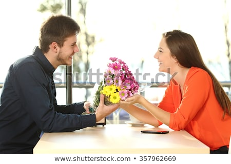young man giving a present to his girlfriend at restaurant stock photo © photography33