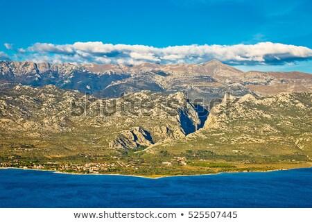 Vue montagnes Croatie coucher du soleil eau paysage Photo stock © Hochwander