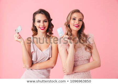 smiling elegant woman holding credit card stock photo © stockyimages