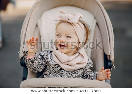 young girl with baby stroller stock photo © gemenacom