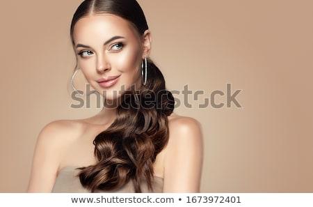 Mooie vrouw paardenstaart lang bruin haar aanraken gezicht Stockfoto © lubavnel