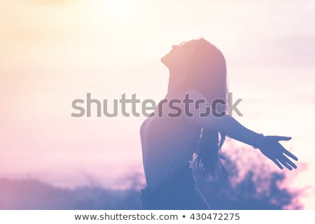 happy woman stretching hands outdoors stock photo © deandrobot