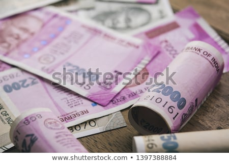 Close-up of rolled-up Indian paper currency Stock photo © imagedb