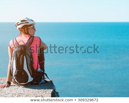 женщину сидят рок морем пейзаж пляж Сток-фото © logoff