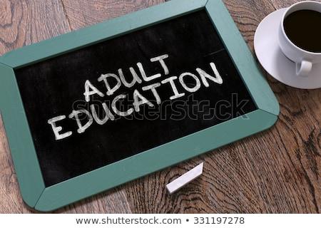 Kształcenie dorosłych Tablica książek budzik Zdjęcia stock © tashatuvango