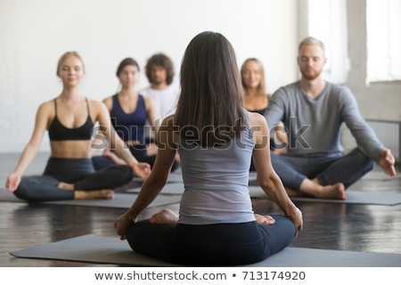 Man sitting in lotus posture, rear view Stock photo © cherezoff