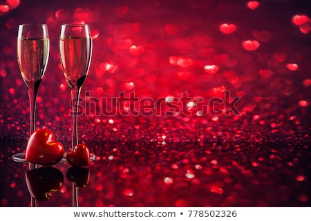 Wineglasses of Sparkling Champagne for Happy Valentines Day Stock photo © smeagorl