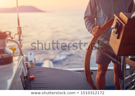 Sail and steering wheel Stock photo © Alina12