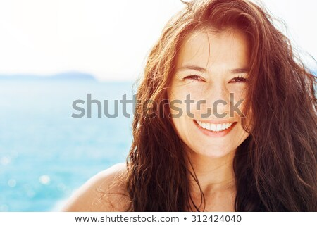Brunette Woman On Tropical Beach. Summer vacation. Happy girl wa Stock photo © Victoria_Andreas