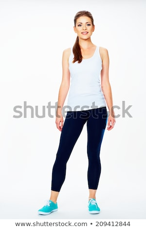Fitness woman in sport style standing against white background. isolated Stock photo © artfotodima