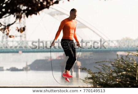 фитнес человека веревку улице природы красивый Сток-фото © NicoletaIonescu