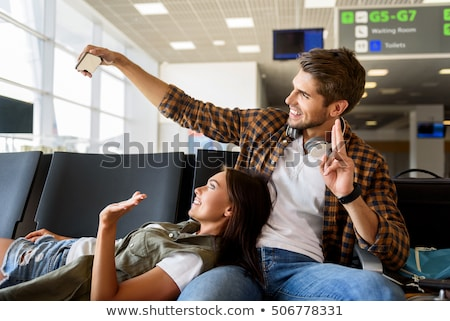 Young caucasian happy traveler gesturing. Stock photo © RAStudio