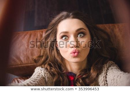 Hermosa niña mentiras sofá nina Foto stock © bezikus