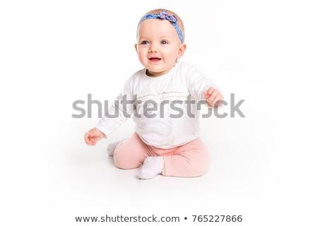serious baby girl sitting on the floor stock photo © feedough