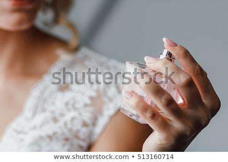 Fiatal nő parfüm nyak kéz mosoly arc Stock fotó © julenochek