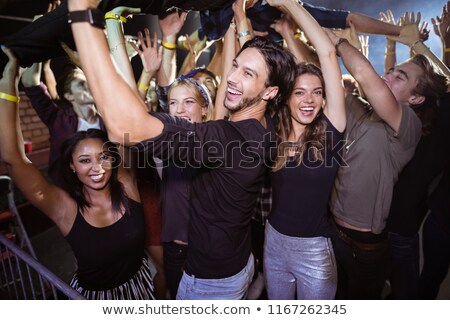 Cheerful crowd lifting female performer at nightclub Stock photo © wavebreak_media