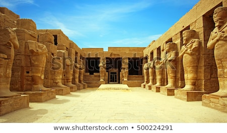 column and statues of sphinx in karnak temple stock photo © mikko