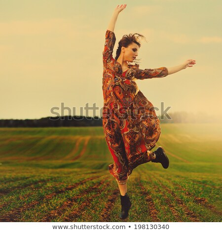 Young girl jumping out of cornfield Stock photo © IS2