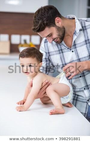 Pai fralda família bebê homem cuidar Foto stock © IS2