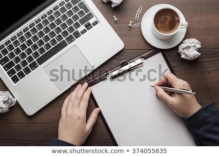 empresário · acima · papel · jovem · sessão · atrás - foto stock © ra2studio